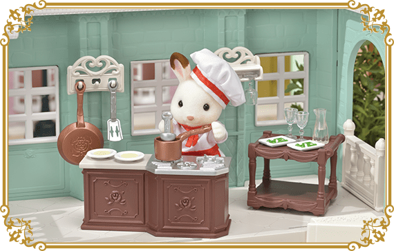 There are detailed sculptures of roses in the kitchen and frying pan.